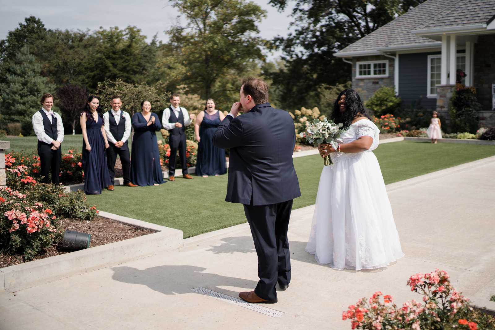 Groom turns round to see his friend dressed in a brides dress