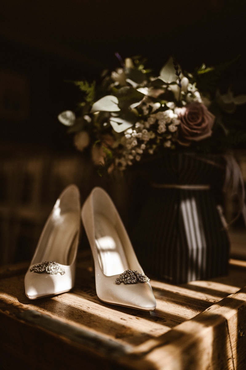 Brides wedding shoes and flowers